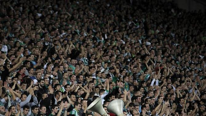 Saint-Etienne supporters cheer during the French League One soccer match against Paris Saint Germain in Saint-Etienne, central France, Sunday Oct. 27, 2013