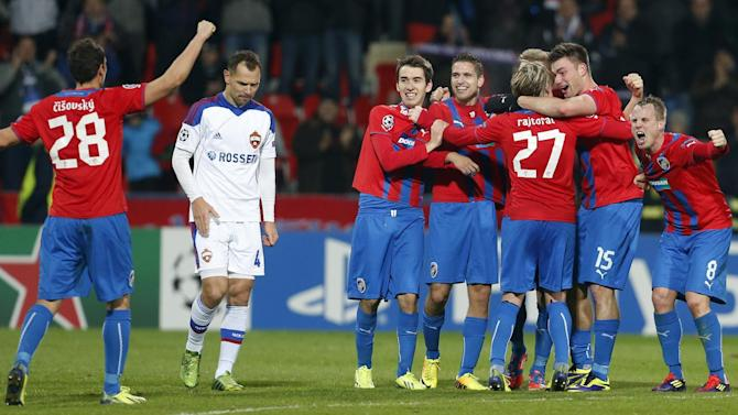 Moscow's Sergei Ignashevich, 2nd right, walks past Viktoria Pilsen players as they celebrate their victory after the Champions League Group D soccer match between Viktoria Pilsen and CSKA Moscow in Pilsen, Czech Republic, Tuesday, Dec. 10, 2013. Pilsen won the match 2-1