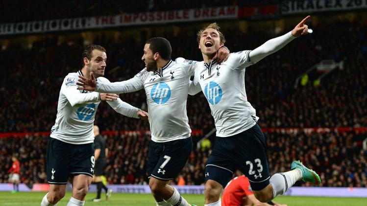 Tottenham Hotspur's Eriksen celebrates his goal against Manchester United with Lennon and Soldado during their English Premier League soccer match in Manchester
