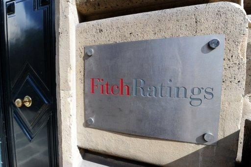 """A picture shows the entrance of Fitch ratings agency in Paris. The credit ratings agency Fitch downgraded on Wednesday debt issued by eurozone member Cyprus by two notches, from """"BB+"""" to """"BB-"""" and said the outlook was negative, which means it could be cut further."""