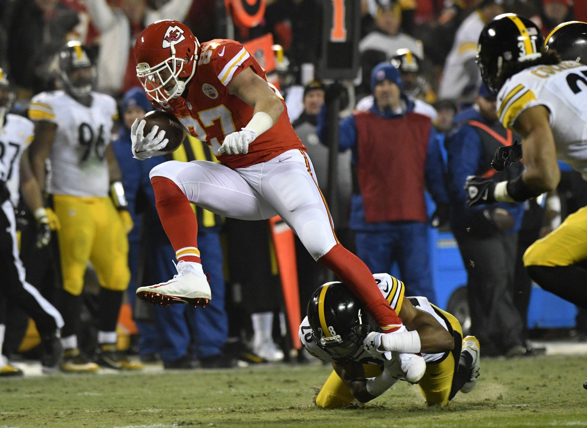 Travis Kelce had some choice words for head referee Carl Cheffers on the hold against Eric Fisher. (AP)