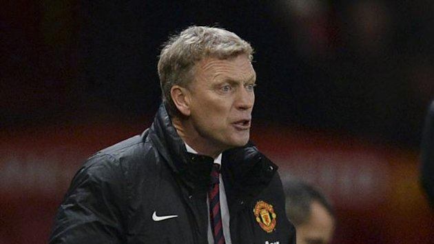 Manchester United's manager David Moyes reacts during their English Premier League match against Everton at Old Trafford, December 4, 2013