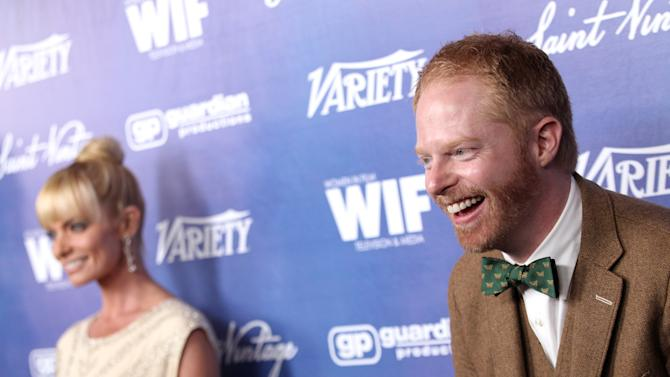 Jesse Tyler Ferguson, right, and Jaime Pressly attend the Variety and Women in Film Pre-Emmy Event at Scarpetta on Friday, Sept. 21, 2012, in Beverly Hills, Calif. (Photo by Matt Sayles/Invision/AP)