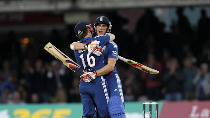 Eoin Morgan and Craig Kieswetter embraec after guiding England to victory over South Africa