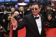 """Chinese director Wong Kar Wai poses on the red carpet on arrival for the opening film of the Berlinale film festival, """"Yi dai zong shi"""" (""""The Grandmaster"""") in Berlin on February 7, 2013"""