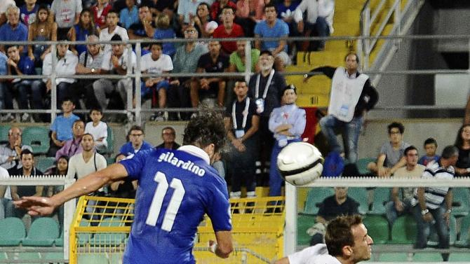 Italy's Gilardino heads to score against Bulgaria during their World Cup qualifying soccer match at the Renzo Barbera Stadium in Palermo