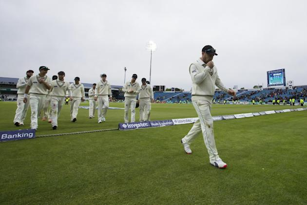 New Zealand's captain Brendon McCullum, right, leads his team from the pitch at close of play on the second day of the second Test match between England and New Zealand at Headingley cricket groun