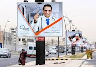 A poster in Tripoli shows a medic holding an election card promoting voting in the National Congress elections. Elections in Libya for a constituent assembly, originally set to be held by June 19, are to be postponed for logistical reasons, electoral commission members said on Saturday