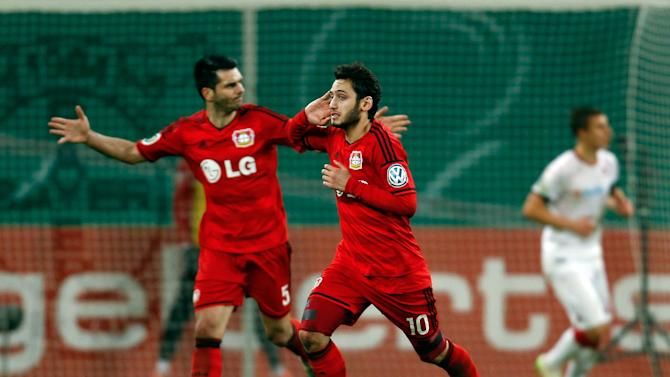 Leverkusen's Calhanoglu celebrates with Spahic after he scored during their German Cup (DFB Pokal) soccer match against Kaiserslautern in Leverkusen