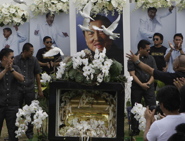 """Doves fly over the tomb of the country's """"King of Comedy"""", Rodolfo Vera Quizon Sr., locally known as """"Dolphy"""", during funeral rites at a cemetery in Taguig, south of Manila, Philippines on Sunday July"""