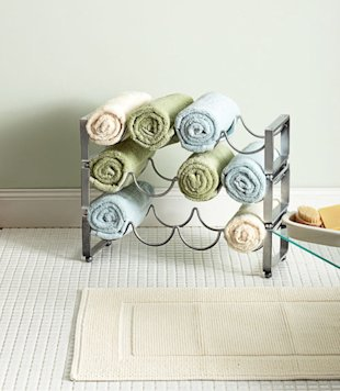 Chic touch: hand towels in a wine rack