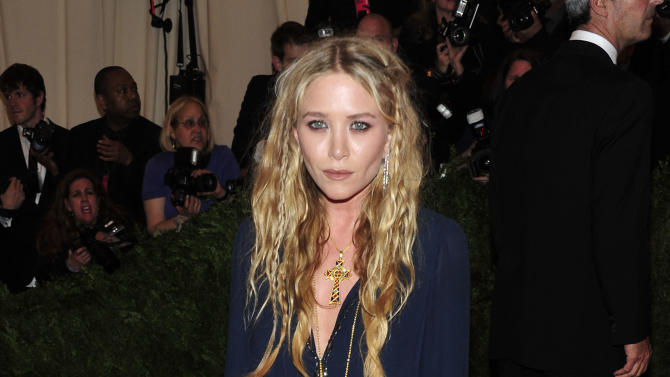 "Mary-Kate Olsen attends The Metropolitan Museum of Art's Costume Institute benefit celebrating ""PUNK: Chaos to Couture"" on Monday May 6, 2013 in New York. (Photo by Charles Sykes/Invision/AP)"