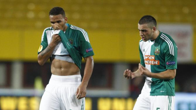 Rapid Vienna's Petsos and Boyd react after their Europa League soccer match at Ernst Happel stadium in Vienna