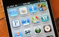 Apps on an iPhone 4S are pictured on December 13, 2012. WhatsApp's mobile messaging service used by hundreds of millions of customers worldwide breached privacy laws in at least two countries, a joint Canadian-Dutch probe concluded Monday
