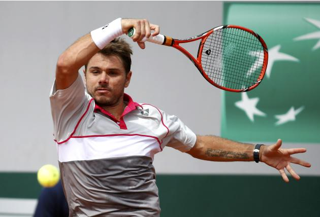 Stan Wawrinka of Switzerland plays a shot to Steve Johnson of the U.S. during their men's singles match at the French Open tennis tournament at the Roland Garros stadium in Paris
