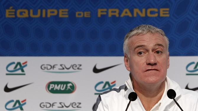 France's soccer coach Didier Deschamps listens during a press conference, at Clairefontaine training center, south of Paris, Sunday, Nov. 17, 2013. Ukraine stunned France with two second-half goals on Friday to win the first leg of their World Cup playoff 2-0 and put the heavily favored visitors in real danger of missing next year's tournament
