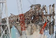 The damaged Reactor 3 building at Tokyo Electric Power Co.'s tsunami-crippled Fukushima power plant is seen February 20, 2012. The operator of Japan's Fukushima nuclear plant insisted Thursday there was no sign of spiking radiation at the crippled facility, after steam was found in a reactor building