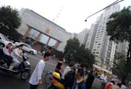 Motorists and pedestrians are seen passing the Chengdu People's Intermediate court in Chengdu, in southwest China's Sichuan province, on September 18, where Wang Lijun, an ex-police chief who triggered the Chinese Communist party's biggest scandal in years, was being tried. Judgement in the case of Wang will be given Monday, a court official told AFP