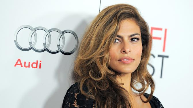 """FILE - This Nov. 3, 2012 file photo shows actress Eva Mendes at the """"Holy Motors"""" special screening as part of AFI Fest in Los Angeles. Mendes is the new face of Vogue Eyewear for their autumn/winter 2013 collection. Mendes is working on her own clothing line for New York & Company and is hoping to have it in stores for the fall. She's also been tapped to represent Vogue eyewear. (Photo by Jordan Strauss/Invision/AP, file)"""