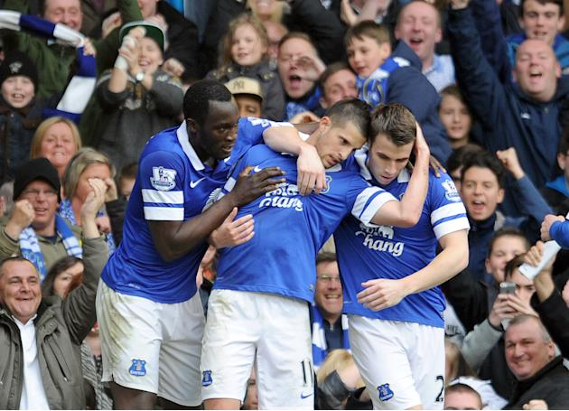 Everton's Kevin Mirallas centre, celebrates with team-mates Leighton Baines right, and Romelu Lukaku left, after he scored the second goal of the game for his side during their English Premier Lea