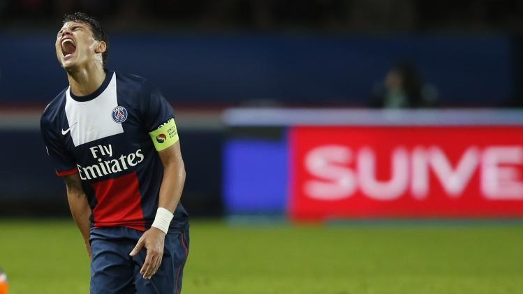 Paris St Germain's Thiago Silva reacts during his French Ligue 1 soccer match against Lille in Paris