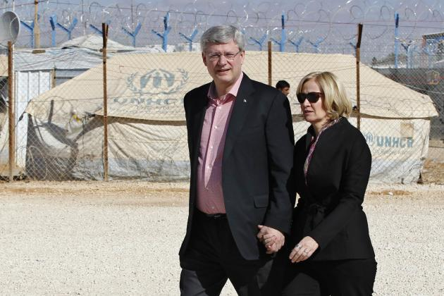 Canada's PM Harper and wife Laureen take tour at center of World Food Program during visit to Al Zaatari refugee camp, in Mafraq