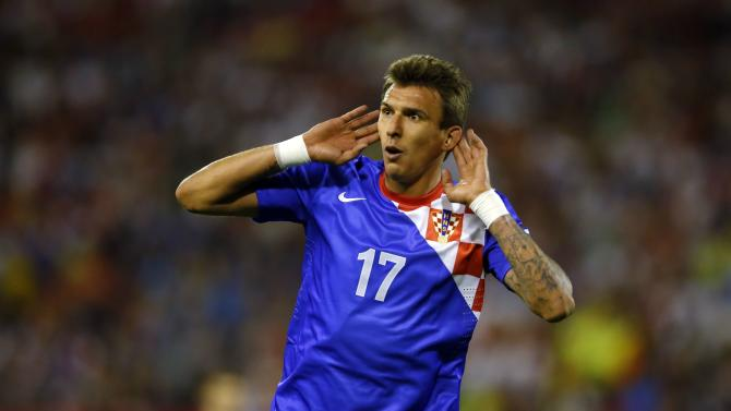 Croatia's Mandzukic celebrates after scoring against Serbia during their 2014 World Cup qualifying soccer match in Belgrade