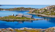 Landscape is pictured near the harbor of Sarnes village in northern Norway on June 7, 2013