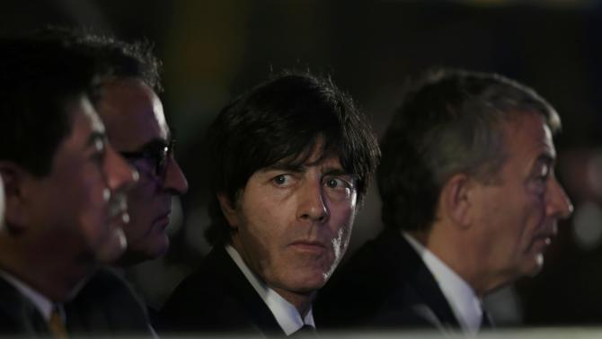 Low looks on during the draw for the 2014 World Cup in Sao Joao da Mata