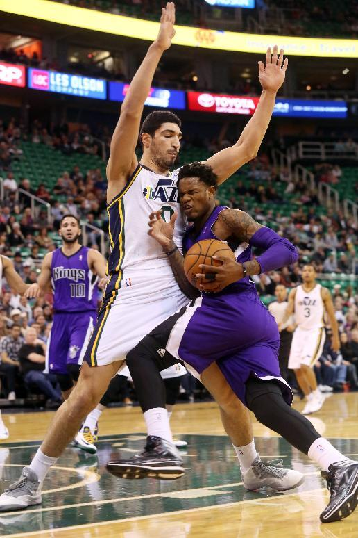 Utah Jazz's center Enes Kanter (0) defends as Sacramento Kings' guard Ben McLemore (R) drives the basket in the first half of an NBA basketball game on Saturday, Dec. 7, 2013, in Salt Lake City