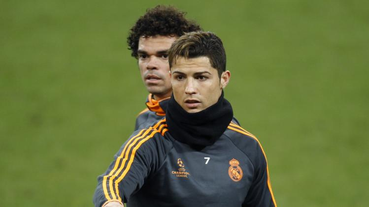 Real Madrid's Cristiano Ronaldo and Pepe react during a training session in Gelsenkirchen