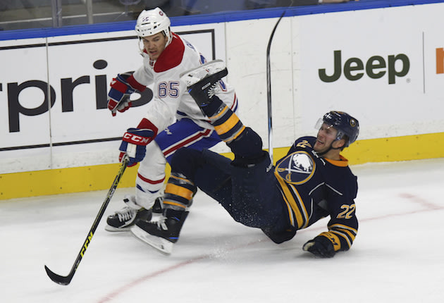 Buffalo Sabres Johan Larsson (22) is tripped up by Montreal Canadiens Andrew Shaw (65) during the first period of a NHL hockey game, Thursday, Oct. 13, 2016, in Buffalo, New York. (AP Photo/Jeffrey T. Barnes)