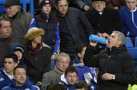 Chelsea's manager Mourinho takes a drink during their English Premier League soccer match against Newcastle United in London