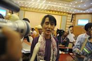 Aung San Suu Kyi speaks to media after taking her parliamentary oath in Naypyidaw on Wednesday. The 66-year-old stood to read the brief oath in unison with 33 other members of her National League for Democracy party elected to the lower house in April