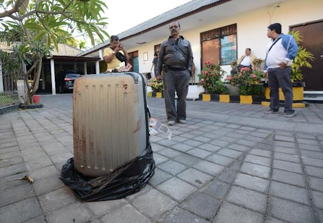 The suitcase in which the body of a US tourist was found is pictured at a police station on the Indonesian resort island of Bali on August 12, 2014