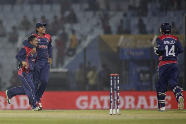 Nepal's bowler Basant Regmi, left, celebrates a wicket with teammates during their ICC Twenty20 Cricket World Cup match against Hong Kong in Chittagong, Bangladesh, Sunday, March 16, 2014. (AP Pho