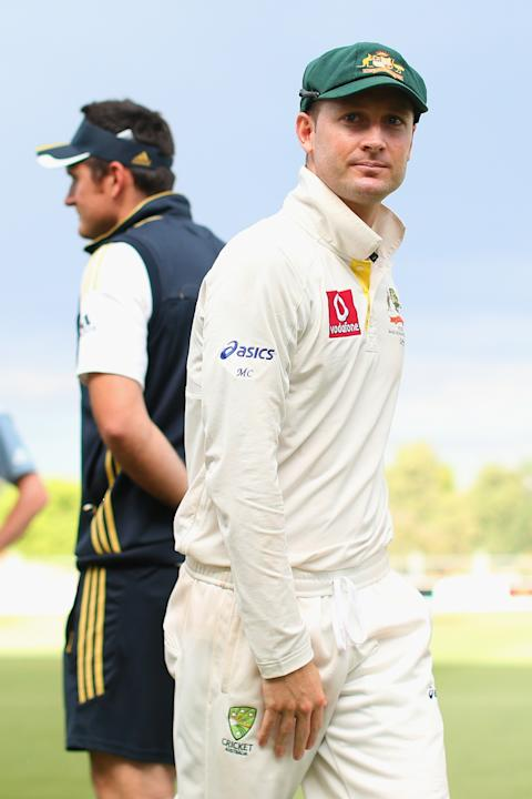 ADELAIDE, AUSTRALIA - NOVEMBER 26:  Australian captain Michael Clarke walks past South African captain Graeme Smith following the end of play on day five of the Second Test Match between Australia and