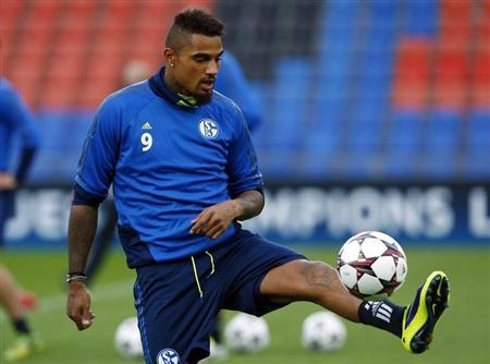 Schalke 04's Kevin-Prince Boateng controls the ball during a training session in Basel