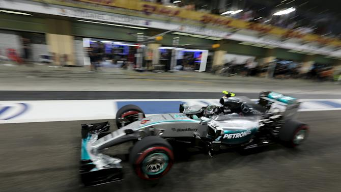Mercedes Formula One driver Nico Rosberg of Germany leaves pits during the qualifying session of Abu Dhabi F1 Grand Prix at the Yas Marina circuit in Abu Dhabi