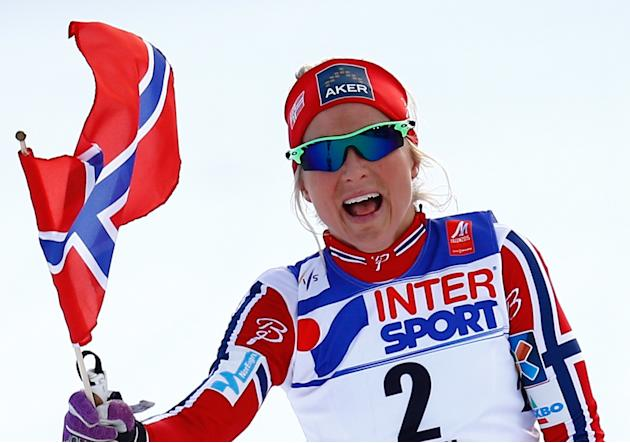 Norway's Johaug celebrates winning the women's cross country 30 km mass start classic race at the Nordic World Ski Championships in Falun