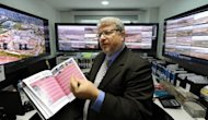 Ricardo Trade, Executive Director of the local organization committee for the FIFA World Cup Brazil 2014, shows the control room, from where the stadiums will be monitored in real time, during an interview with AFP in Rio de Janeiro, Brazil
