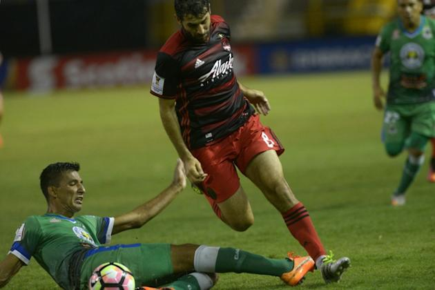 Diego Valeri of Portland Timbers (R) fights for the ball with Raul Gonzales of Salvadorean team C.D. Dragon during a CONCACAF Champions League football match in September