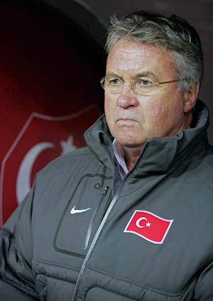 Turkey's coach Guus Hiddink watches the game during the first leg of their Euro 2012 play-off qualifying soccer match with Croatia at Turk Telekom Arena in Istanbul, Turkey, Friday, Nov. 11, 2011. (AP Photo)