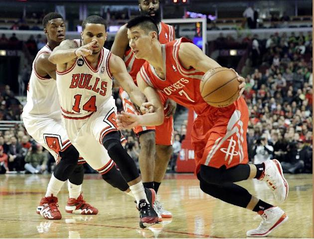 Houston Rockets guard Jeremy Lin (7) drives to the basket as Chicago Bulls guard D.J. Augustin (14) guards during the first half of an NBA basketball game in Chicago on Thursday, March 13, 2014