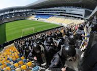 Riot policemen on an exercise at Lviv Arena stadium last week, as part of preparations for the Euro 2012 football tournament. A new film shows Soviet footballers refusing to throw a game against Nazi occupiers though they know it will lead to their deaths