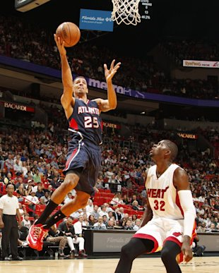 MIAMI, FL - December 3: Thabo Sefolosha #25 of the Atlanta Hawks goes for the lay up against James Ennis #32 of the Miami Heat during the game on December 3, 2014 at American Airlines Arena in Miami, Florida. (Photo by Isaac Baldizon/NBAE via Getty Images)