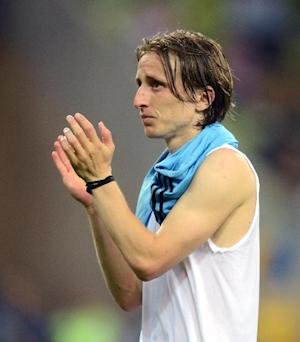 Luka Modric made his debut for Real in their second-leg Supercopa win over Barcelona