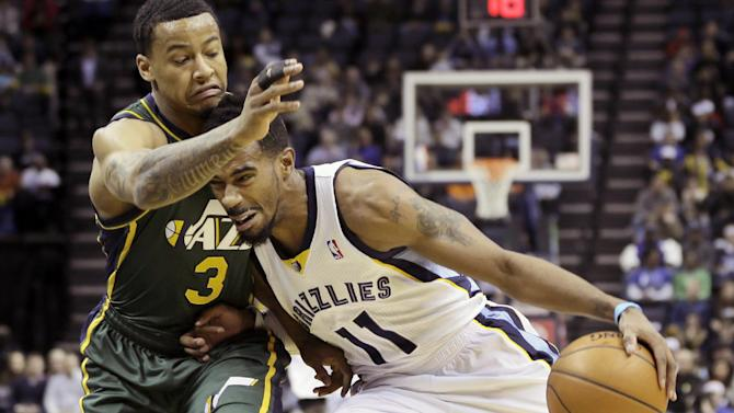 Utah Jazz's Trey Burke (3) defends against Memphis Grizzlies' Mike Conley (11) in the first half of an NBA basketball game in Memphis, Tenn., Monday, Dec. 23, 2013