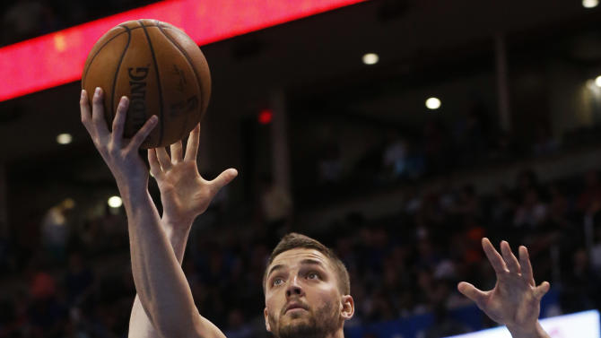 Dallas Mavericks forward Chandler Parsons (25) shoots in front of Oklahoma City Thunder forward Kyle Singler (5) in the first quarter of an NBA basketball game in Oklahoma City, Wednesday, April 1, 2015. Dallas won 135-131. (AP Photo/Sue Ogrocki)