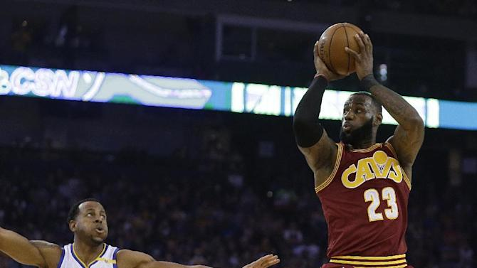 Cleveland Cavaliers' LeBron James, right, shoots over Golden State Warriors' Andre Iguodala (9) during the first half of an NBA basketball game, Monday, Jan. 16, 2017, in Oakland, Calif. (AP Photo/Ben Margot)